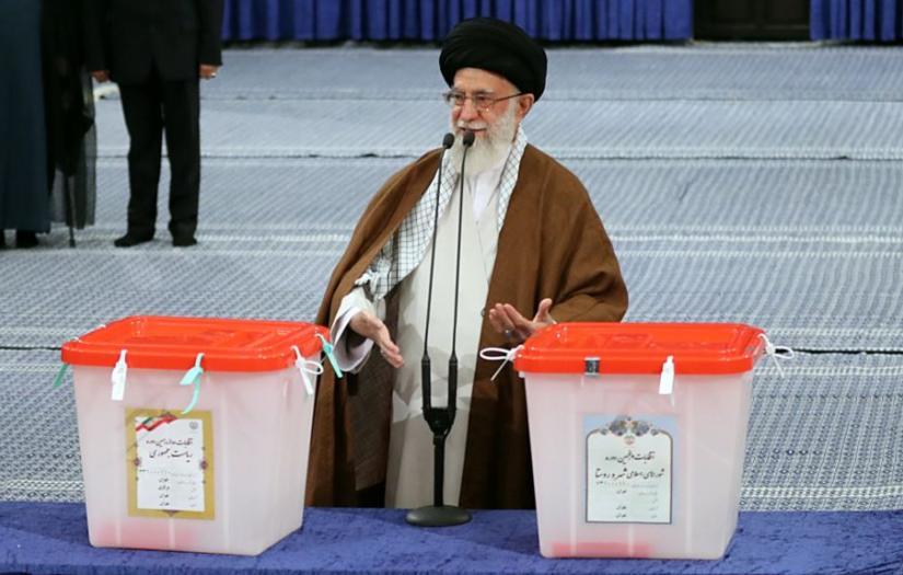 Iran's Supreme Leader Ali Khamenei at the ballot box in 2017. FILE