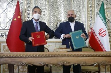 Chinese and Iranian foreign ministers after they sign a 25-year agreement. March 27, 2021