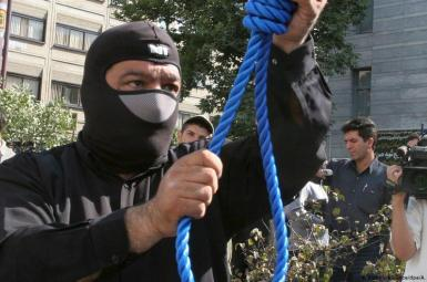 An executioner prepares for public hanging in Iran. FILE