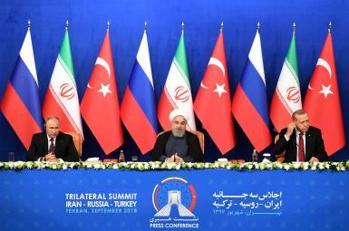 حسن روحانی، رییس جمهوری ایران، بههمراه ولادیمیر پوتین و رجبطیب اردوغان، همتایان روس و ترک خود در نشست تهران