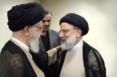 Ebrahim Raeesi (R) with Supreme Leader Ali Khamenei. FILE PHOTO
