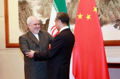 Chinese foreign minister Wang Yi and Javad Zarif in a meeting in 2020.