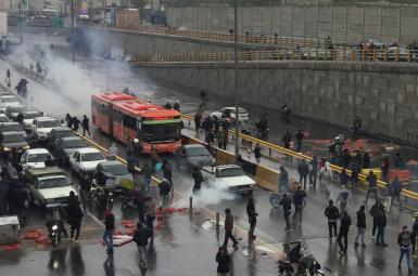 Protesters block roads in Tehran before security forces crack down, killing hundreds. November 15, 2019