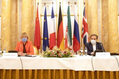 European Union's External Action Service (EEAS) Helga Schmid and Iran's Deputy Foreign Minister Abbas Araghchi. FILE