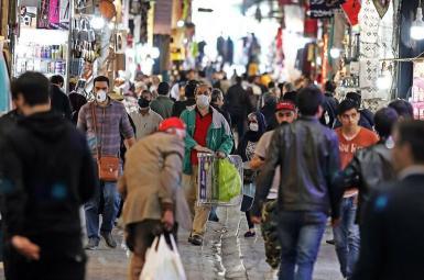 People walk in Bazaar in Tehran, Iran's capital. FILE