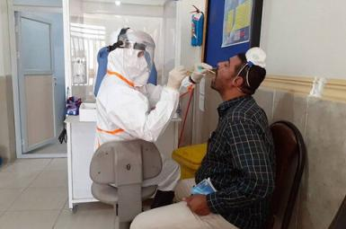 A man being tested for Coronavirus infection in Tehran. File
