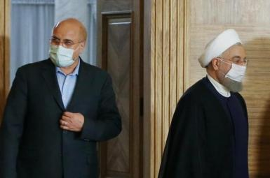 Iran's parliament speaker Ghalibaf (L) and president Hassan Rouhani. FILE