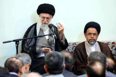 Iran's Intelligence Minister Alavi sitting next to Supreme Leader Khamenei. FILE