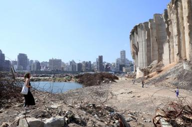 A woman walks in the rubble of Beirut's port after last year's explosion. July 13, 2021