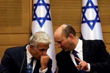 Israeli Prime minister Naftali Bennett and Foreign minister Yair Lapid attend first cabinet meeting June 13, 2021.