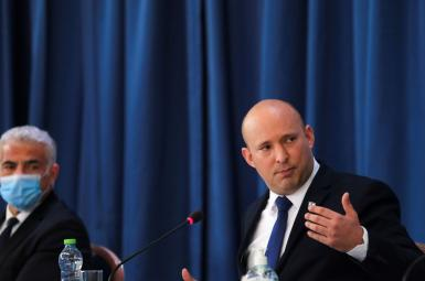 Israeli Prime Minister Naftali Bennett chairs the weekly cabinet meeting, August 22, 2021.