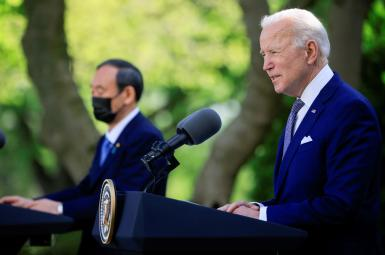 President Joe Biden speaks alongside Japan's Prime Minister Yoshihide Suga as they hold a joint news conference. April 16, 2021