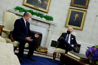 US President Joe Biden and Israel's Prime Minister Naftali Bennett chat during a meeting at the White House, August 27, 2021.
