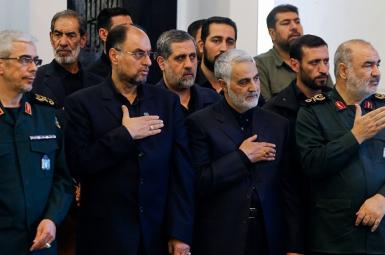 Qasem Soleimani (2nd R) with military commanders and officials. Undated
