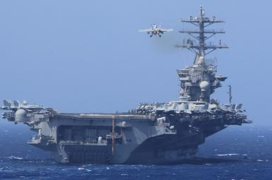 An F/A-18E US Navy plane taking off from an aircraft carrier. FILE PHOTO