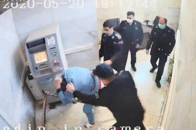 Video grab - Guards beating a handcuffed prisoner in Iran's Evin prison. Undated.