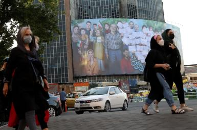 A large poster in Tehran urges people to vote on June 18. June 16, 2021
