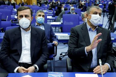 Iranian Atomic Energy Agency (IAEA) Chief Mohammad Eslami (R) and Iran's ambassador to the IAEA Kazem Gharibabadi attend the opening of the IAEA General Conference at their headquarters in Vienna, September 20, 2021.