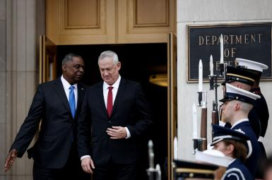 US Defense Secretary Lloyd Austin greets Israel's Defense Minister Benny Gantz during an enhanced honor cordon at the Pentagon June 3, 2021.