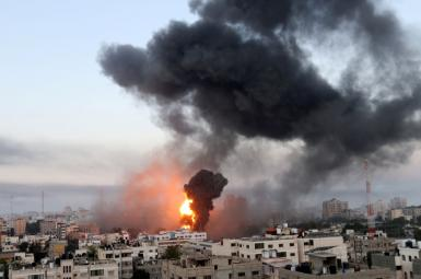 Smoke and flames rise during Israeli air strikes amid a flare-up of Israeli-Palestinian violence, in Gaza May 12, 2021.