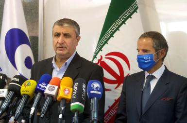 Head of Iran's Atomic Energy Organization Mohammad Eslami and IAEA Director General Rafael Grossi attend a news conference, in Tehran, September 12, 2021.