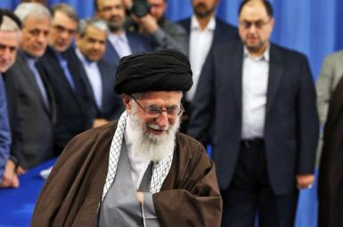 Supreme Leader Ali Khamenei with Haghanian to his left. FILE