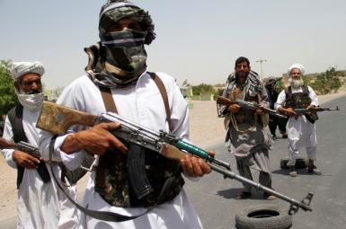 Former Mujahideen hold weapons to support Afghan forces in their fight against Taliban, on the outskirts of Herat province, Afghanistan July 10, 2021.