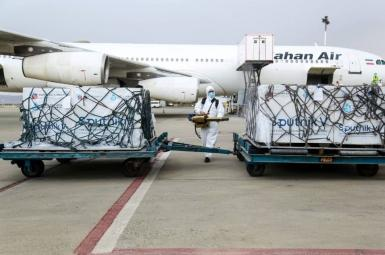 An Iranian airliner unloading Covid vaccines.