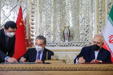 """Iranian and Chinese foreign ministers signing a 25-year """"strategic"""" agreement. March 27, 2021"""