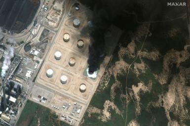 A satellite view shows a closer view of burning storage tank in southern Israel May 12, 2021.