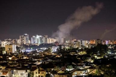 Smoke rises over houses in Ashkelon following a rocket attack launched from Gaza towards Ashkelon, southern Israel, May 14, 2021.