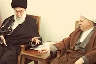 Screen grab from a 2012 video showing Khamenei and Rafsanjani in a debate over relations with the US.