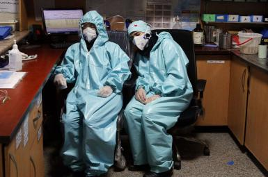 Two exhausted health workers in Iran's Khuzestan province. March 14, 2021