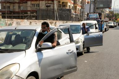 Lebanese pushing their cars near a gas station in Beirut amid fuel shortages. August 17, 2021