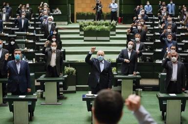 Members of hardliner-dominated Iranian parliament listen to a speech by Khamenei. July 12, 2020