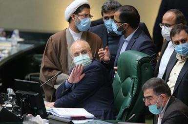 Speaker of parliament Mohammad Bagher Ghalibaf surrounded by lawmakers. February 2, 2021