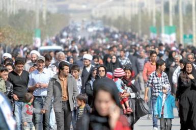 General view of people walking in a Tehran street. Undated