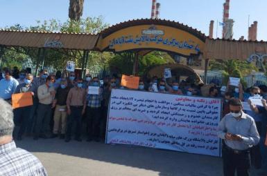 Striking workers outside one of Abadan refinery buildings. June 23, 2021