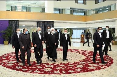 President Hassan Rouhani surrounded by senior officials on his way to meet foreign ambassadors. February 9, 2021