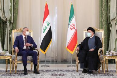 Iraqi PM Mustafa al-Kadhimi (L) and Iran's president Ebrahim Raisi. September 12, 2021
