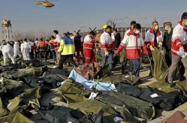 Rescue workers comb the debris after the downing of airliner. January 8, 2020