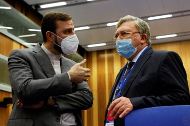Iran's ambassador to IAEA Kazem Gharibabadi talks to Russia's Governor to the IAEA Mikhail Ulyanov before the beginning of a board of governors meeting in Vienna September 13,