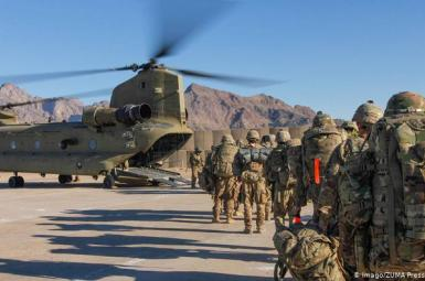 US forces in Afghanistan boarding a large helicopter. Undated