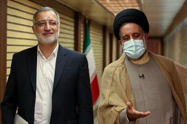Hardliner Iran presidential candidate Alireza Zakani (L) Walking to first debate. June 5, 2021