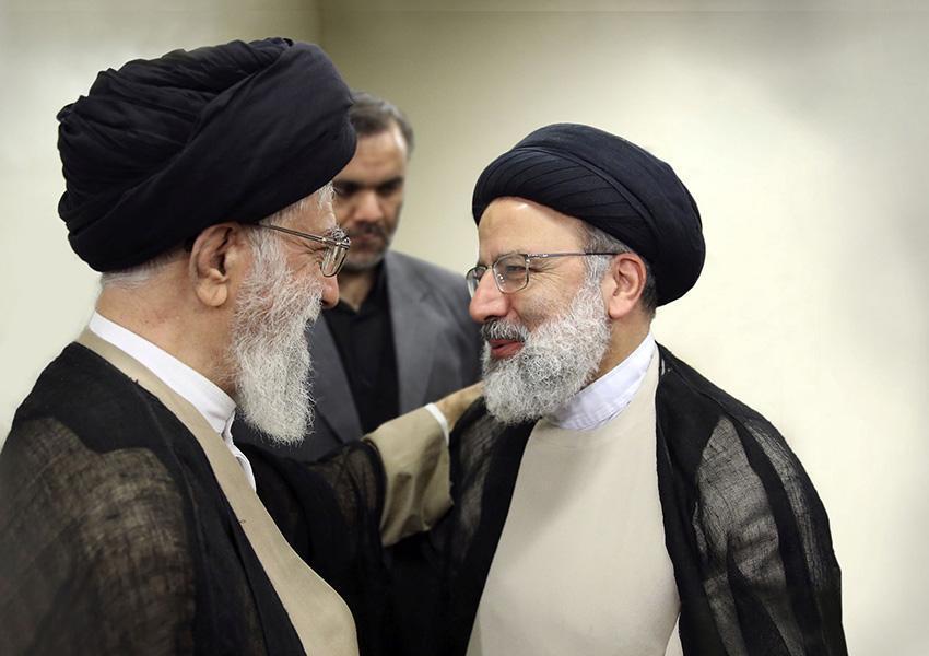 Hardliner Judiciary chief Ebrahim Raeesi (R) with Supreme Leader Ali Khamenei. FILE PHOTO
