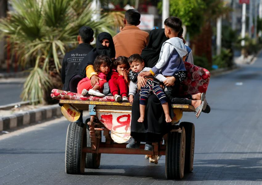 Palestinians riding on a donkey-drawn cart flee their homes during Israeli air and artillery strikes, in Gaza City May 14, 2021.