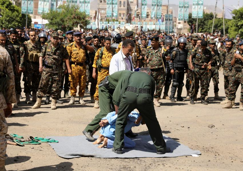 Houthis prepare a man to be executed at Tahrir Square in Sanaa, Yemen September 18, 2021.