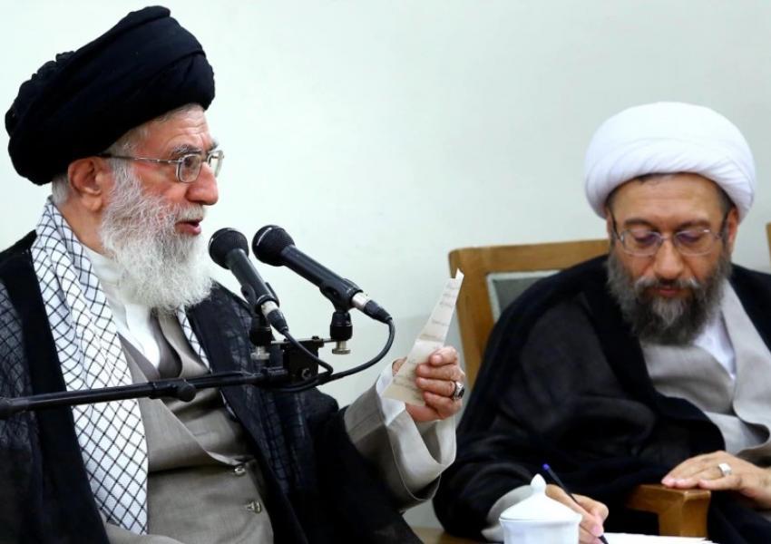 Sadegh Amoli Larijani in his heydays with Supreme Leader Ali Khamenei in 2014.