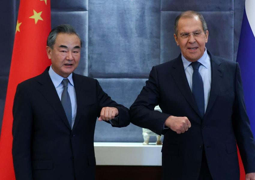 Russian Foreign Minister Sergei Lavrov meets with Chinese Foreign Minister Wang Yi on the sidelines of the Shanghai Cooperation Organization (SCO) summit in Tajikistan September 16, 2021.
